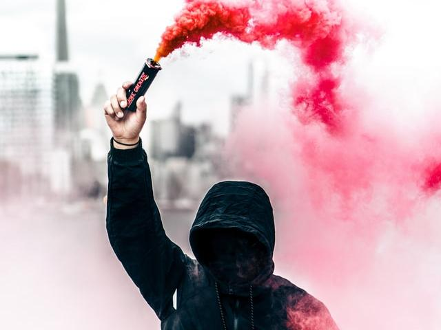 Person with pink smoke in Toronto, Canada